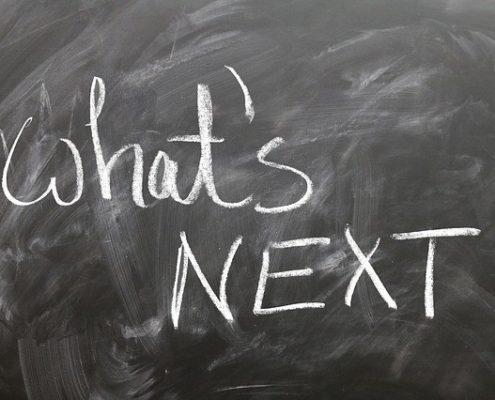 """What's Next"" written on a chalk board"