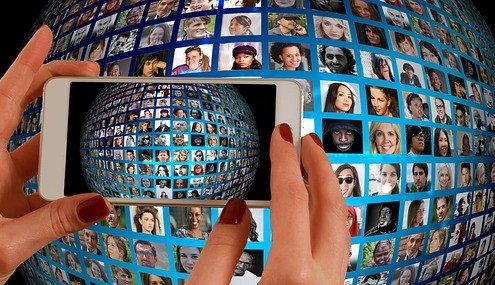 smartphone taking a photo of a sphere with photos of people