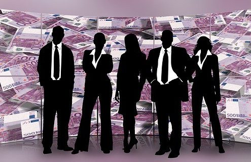 business men in black with pink money in the background