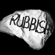 """A large pice of white paper crumbled and written """"rubbish"""" in black"""