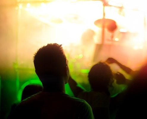 A man in a music concert mesmerized by the music