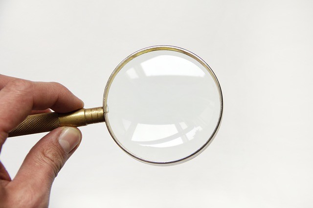 a magnifying glass zooming into nothing