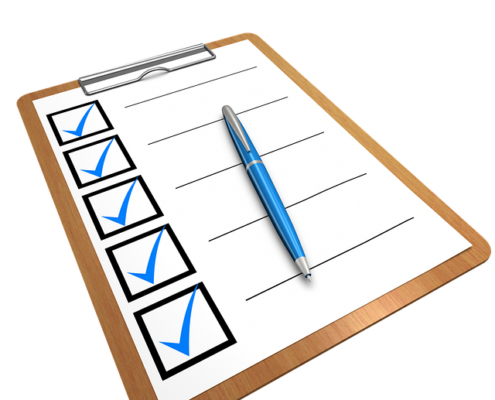 A clipboard with blue checks and a blue pen