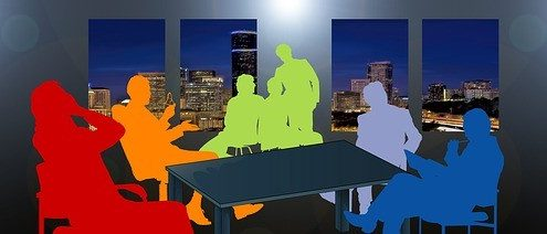 Different colors of business men and women icons inside a office