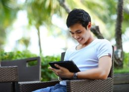 Asian man with a tablet device on a vacation