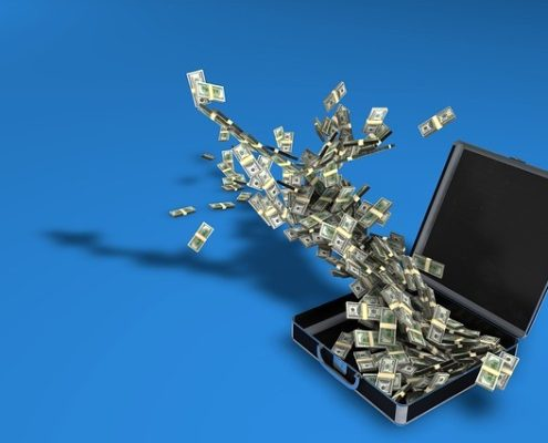 A stack of money flowing out of brief case in a blue room