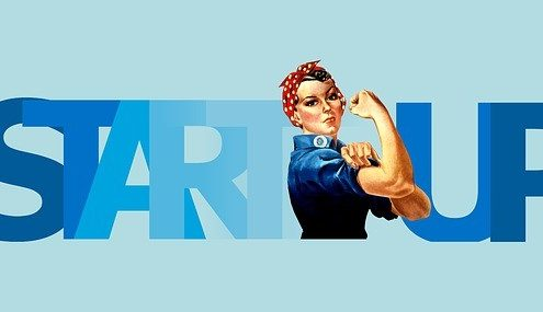 """A fit animated woman in front of a blue sign spelled """"Start Up"""""""