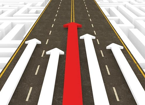 4 whit arrows and 1 red arrow racing on a road
