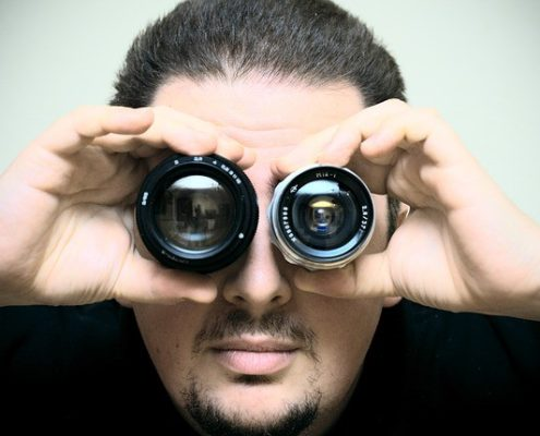 A man with two camera lenses