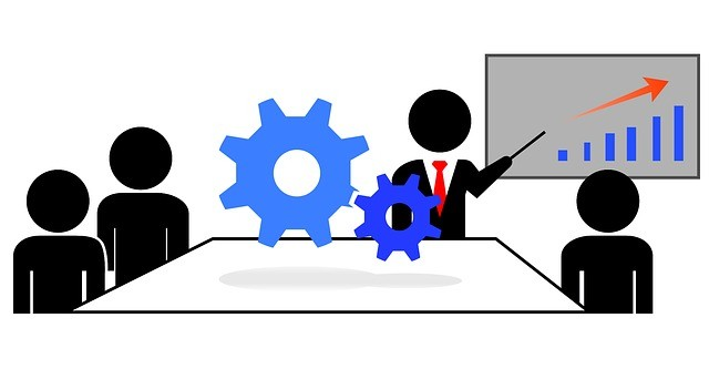A meeting with business stick men with a blue chart